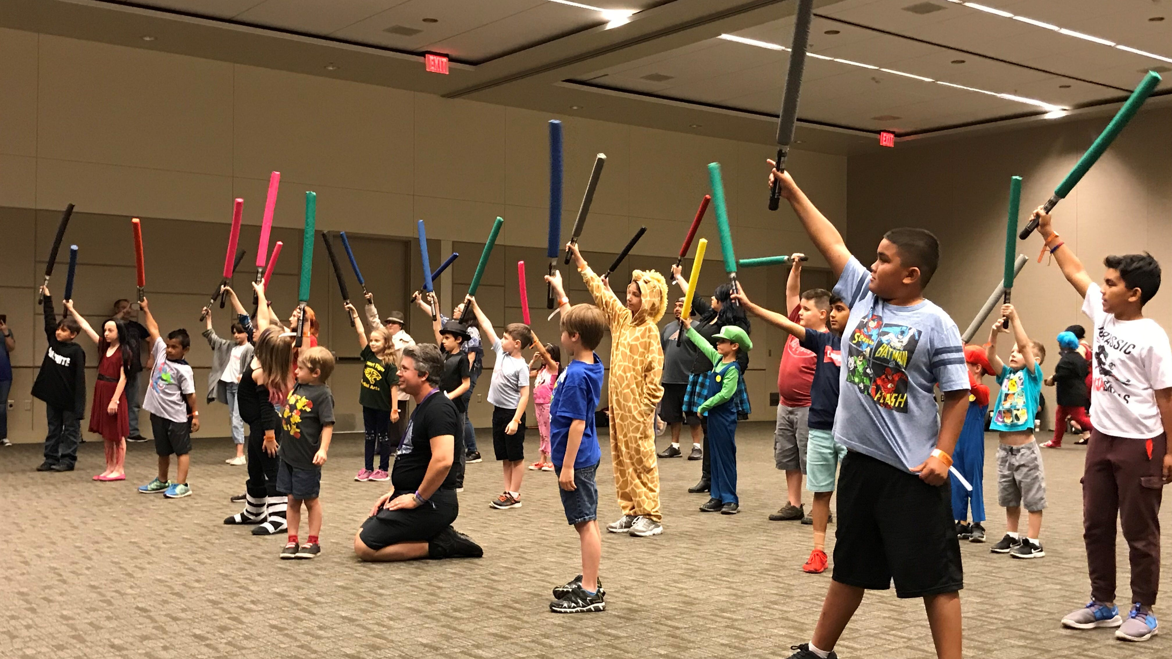 Young Padawans practice the art of the lightsaber at Phoenix Fan Fusion on May 23, 2019.