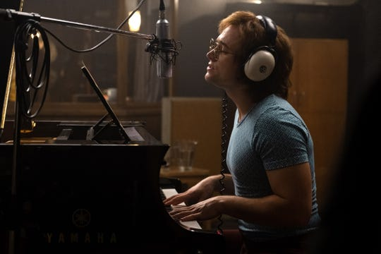 "Elton John (Taron Egerton) records in ""Rocketman."""