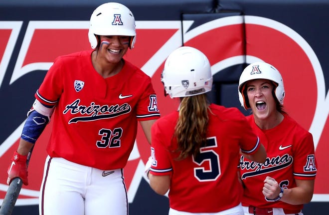 "Arizona's Alyssa Palomino-Cardoza, left, would love to give coach Mike Candrea another national championship. ""He deserves it,"" she said."