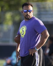 North Canyon High football head coach Airabin Justin watches practice in Phoenix, Ariz. August 7, 2017.