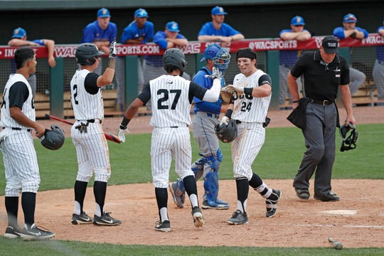 Kona Quiggle (24) hits a three-run homer to lead GCU to a first-round win over Cal State-Bakersfield in the WAC Tournament at Hohokam Stadium on Wednesday.