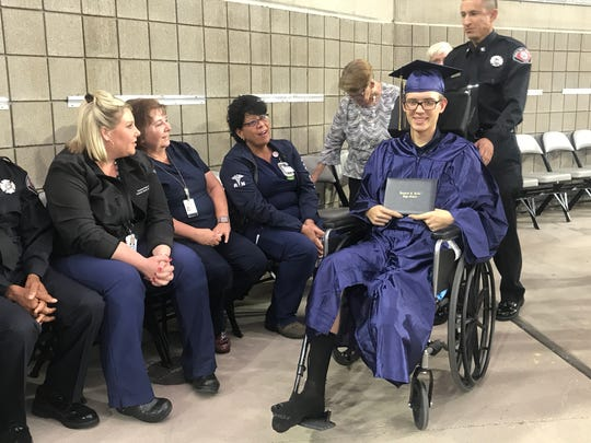 17-year-old Erik Peterson, who got in a serious motorcycle crash last week that resulted in his lower leg being amputated, graduated with his peers at Raymond S. Kellis High School at State Farm Stadium in Glendale on Wednesday, May 22, 2019.