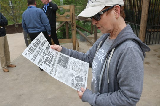 "Monica Olejko, one of the directors for the performers in Cedar Point's new Forbidden Frontier on Adventure Island, reads the latest news in ""The Island Ledger."""