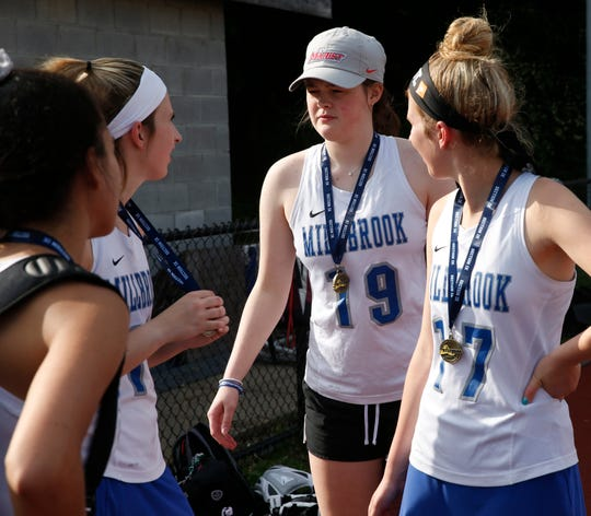 Twins Carrie (left) and Cat Halpin talk to Millbrook girls lacrosse teammate Erin Fox after capturing the Section 9 Class D title on Wednesday.