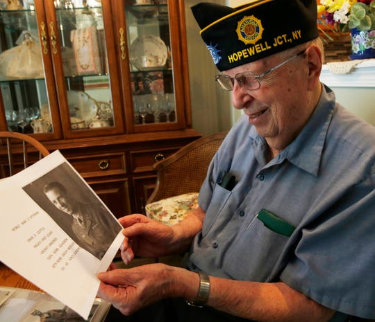 Owen Cottle looks at a portrait of him from World War II in his home in Fishkill on May 23, 2019.