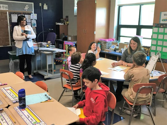 Rahshene Davis, an assistant superintendent in the School District of Philadelphia, watches second-grade teacher Andrea Peiffer lead a group reading lesson at South Hamilton Elementary in Chambersburg on May 17, 2019.
