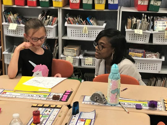 Rahshene Davis, an assistant superintendent in the School District of Philadelphia, talks to second-grader Ava Peterson during a visit to South Hamilton Elementary in Chambersburg on May 17, 2019.