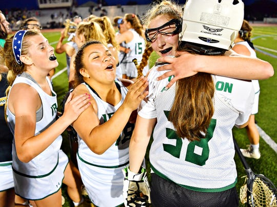 York Catholic celebrates a 12-9 win over Kennard-Dale during District III, Class 2-A girls' lacrosse championship action at Central Dauphin Middle School in Harrisburg, Wednesday, May 22, 2019. Dawn J. Sagert photo