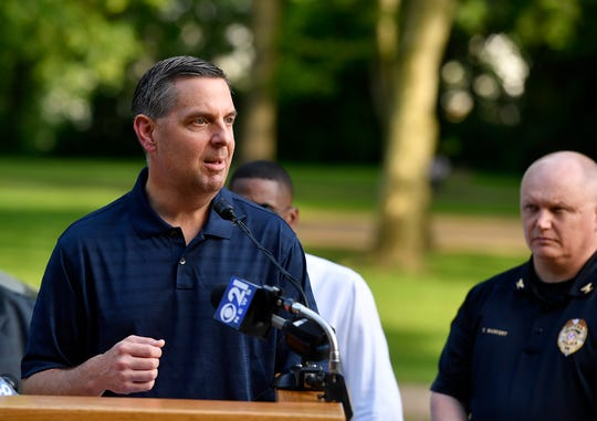 David Freed, U.S. Attorney's Office for the Middle District of Pennsylvania, and several federal, state and local law enforcement agencies join forces with the York City community to conduct neighborhood walks in York to reduce crime and build trust, Wednesday, May 22, 2019.