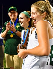 York Catholic Head Coach Rob Linthicum, left, looks on as York Catholic celebrates a 12-9 win over Kennard-Dale during District III, Class 2-A girls' lacrosse championship action at Central Dauphin Middle School in Harrisburg, Wednesday, May 22, 2019. Dawn J. Sagert photo