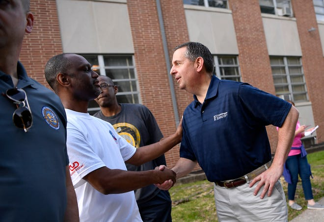 """David Freed, U.S. Attorney's Office for the Middle District of Pennsylvania, greets Shiloh Church """"Street Soldier"""" Fred Walker before a neighborhood walk in York to reduce crime and build trust, Wednesday, May 22, 2019.John A. Pavoncello photo"""