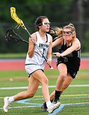 Kennard-Dale's Mikayla Hostler, right, defends against York Catholic's Olivia Staples during District III, Class 2-A girls' lacrosse championship action at Central Dauphin Middle School in Harrisburg, Wednesday, May 22, 2019. Dawn J. Sagert photo