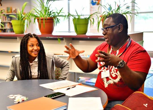 Eighth-grader Navia Chambers, who aspires to be an ICU Charge Nurse, is interviewed by York City School Director Michael Breeland during a mock job interview at Hannah Penn K-8 School in York City, Thursday, May 23, 2019. The day is a culmination of efforts to train and guide students through the process of preparing a portfolio to market themselves for jobs, as well as coaching them through the interview process. Dawn J. Sagert photo