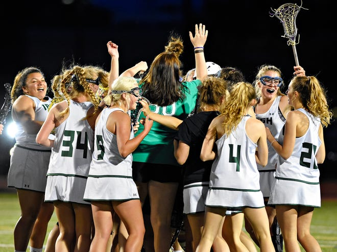The York Catholic girls' lacrosse players celebrate their 12-9 win over Kennard-Dale during the District 3 Class 2-A championship match at Central Dauphin Middle School in Harrisburg on Wednesday, May 22. The Irish hope to be celebrating again after Tuesday's PIAA Class 2-A state semifinal meeting vs. Springfield Delco. Dawn J. Sagert photo