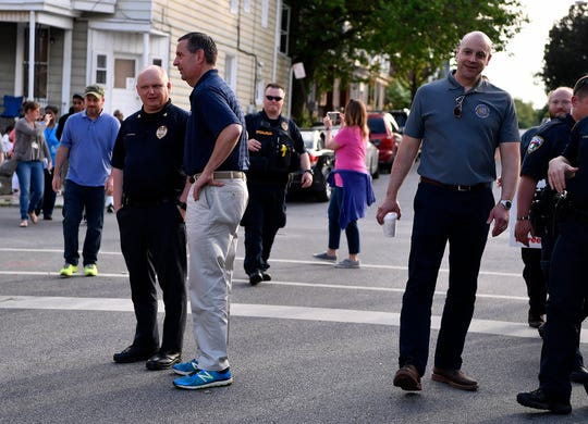 Chief Troy Bankert, left, and David Freed, US Middle District Attorney, join York DA David Sunday and other local, state, and federal law enforcement representatives and community members as they walk the S. Belvidere Ave. neighborhood, Wednesday, May 22, 2019.