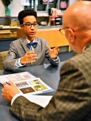 Eighth-grader Yandel Principe is interviewed by Hannah Penn Human Resources Director Rob Bernhard during a mock job interview at Hannah Penn K-8 School in York City, Thursday, May 23, 2019. The day is a culmination of efforts to train and guide students through the process of preparing a portfolio to market themselves for jobs, as well as coaching them through the interview process. Dawn J. Sagert photo