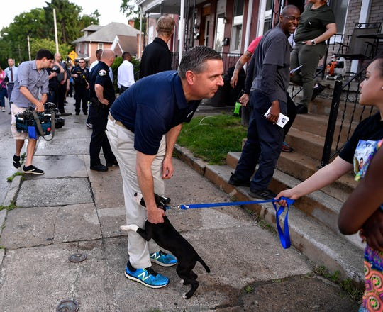 David Freed, U.S. Attorney's Office for the Middle District of Pennsylvania, talks with residents while walking through the S. Belvidere Ave. neighborhood with local, state and federal law enforcement representatives and community members, Wednesday, May 22, 2019.