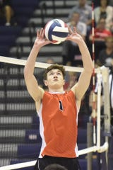 Central York junior setter Brock Anderson passes to a teammate in a match May 22.