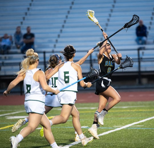 Megan Halczuk (9) prepares to shoot during the District 3 girls' lacrosse title game between York Catholic and Kennard-Dale at Central Dauphin Middle School, Wednesday, May 22, 2019. The Fighting Irish defeated the Rams 12-9.