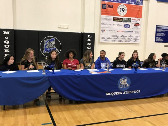 McQueen student-athletes sign for college athletics in a ceremony at the school on Thursday.