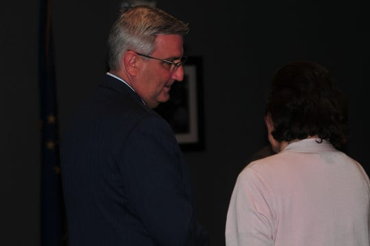 Gov. Eric Holcomb speaks with Mary Ann Butters during the Wayne County Republican Party Lincoln Day Dinner.