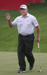 Scott Parel waves to the cheering fans after sinking his putt for birdie on the 18th hole, giving him a score of 66 during the first round of the  Senior PGA Championship at Oak Hill Country Club in Pittsford Thursday, May 23, 2019.
