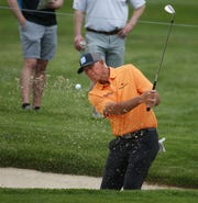 Tom Lehman chips out of the bunker on 11 at the Senior PGA at Oak Hill.