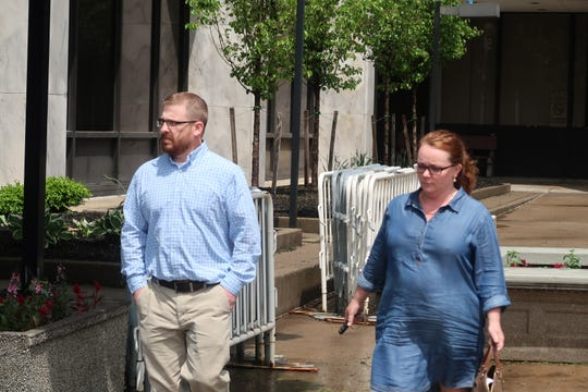 James Smalley, left, walks out of U.S. District Court on Thursday in Rochester after making his initial appearance. Smalley is accused of forging inspection reports for rocket parts that were sold to SpaceX.