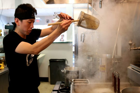 Rocky Yang, owner and head chef, prepares a bowl of ramen at Ibendoo Ramen in Salem on May 23, 2019.