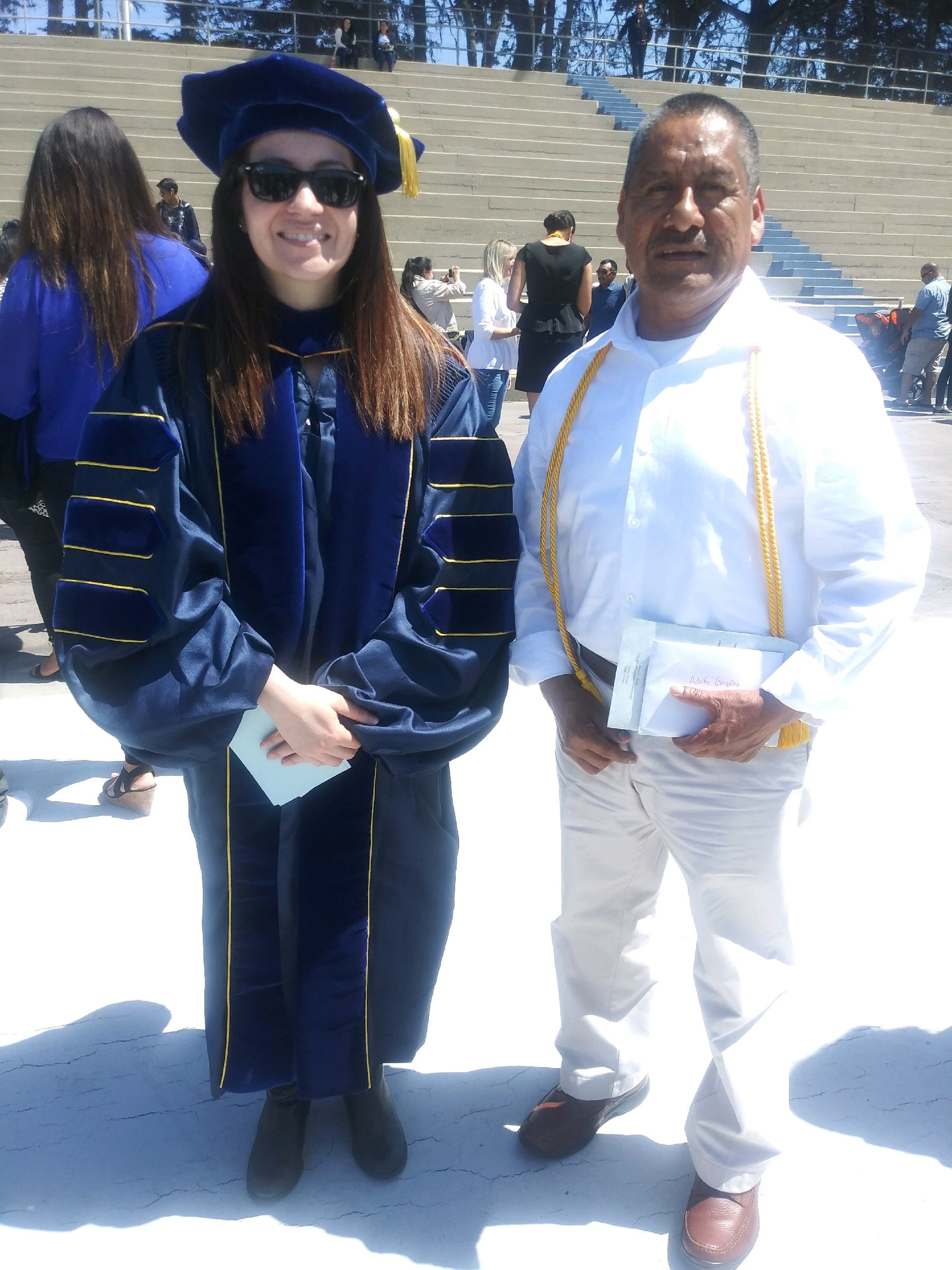 Christine Fernandez, a professor of Spanish at the World Languages and Cultures school, stands with Adolfo González at California State University, Monterey Bay's honors convocation on May 11, 2019.