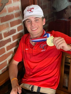 Garden City senior Hagan Halfmann poses with his state medal after the tournament on Tuesday, May 21, 2019.