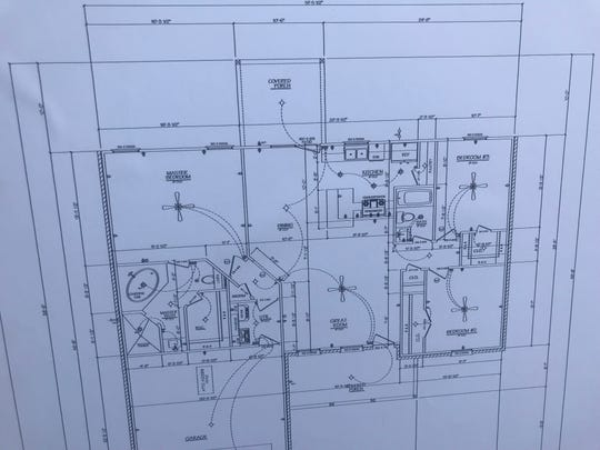 This floor plan depicts a three-bedroom house on a 2,200 square-foot slab, with a garage and a covered porch, which will be built in Grape Creek by Galilee Community Development Corporation as part of their affordable housing campaign.