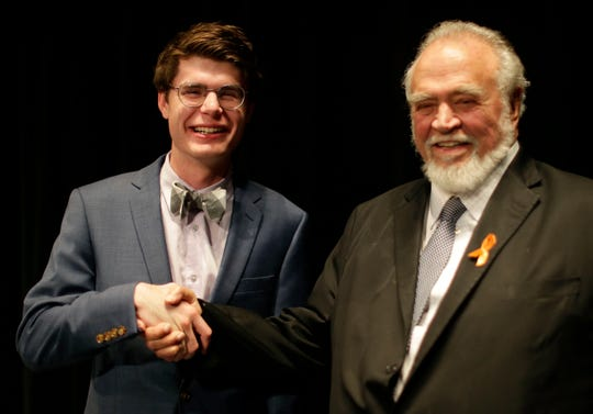 Herbert V. Kohler, Jr., right, poses with Herbert V. Kohler scholarship winner Sheboygan North High School's Noah Bartelt at the Kohler High School Honors Night, Wednesday, May 22, 2019, at Horace Mann Auditorium in Sheboygan, Wis.