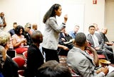 Omari Ho-Sang talks to city officials during the community meeting about the death of Anthony Childs.