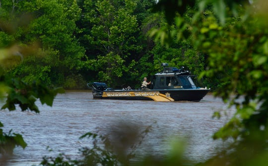 Bossier Parish Sheriff deputies search the Red River on Wednesday, May 22, 2019, for a man who reportedly jumped from the I-20 bridge that afternoon.