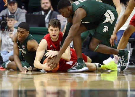 Mar 5, 2019; East Lansing, MI, USA; Nebraska Cornhuskers forward Brady Heiman (45) and Michigan State Spartans forward Aaron Henry (11) and Michigan State Spartans forward Gabe Brown (13) fight for a loose ball during the first half of a game at the Breslin Center.