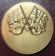Medallions sculpted by Jurek Jakowicz.