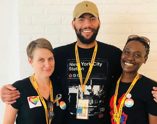 Courtney Coduri, Lance Crawford and Sabrina Burress, residents in counseling, volunteering at Staunton Pride's Warm Room, an ARROW Project led event.