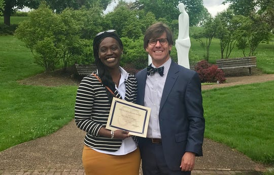 Sabrina Burress, resident in counseling and executive director, and Charles Shepard, clinical director, at Eastern Mennonite University's Master of Arts in Counseling Commissioning ceremony. Burress received the alumni award for the work of the ARROW Project, which came with a monetary gift to support its continued work and growth.