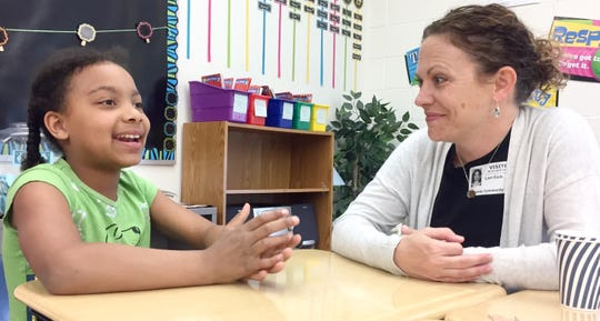 Maia Fremo, a third-grader, talks to her pen pal Lori Eich about an upcoming vacation. The two pen pals met in person for the first time Thursday, May 23 at Kennedy Community School in St. Joseph.