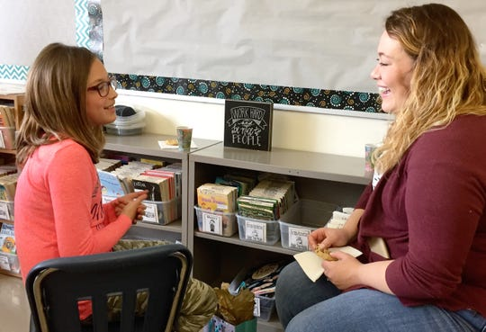 Elleah Eiynck, a third-grader, talks to her pen pal Samantha Ernst during a meet-and-greet Thursday, May 23 at Kennedy Community School in St. Joseph.