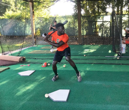FAMU outfielder Willis McDaniel takes his cuts in the batting cage during practice on Tuesday, May 21, 2019.