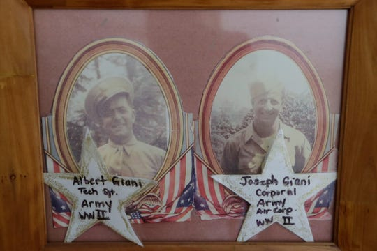 Framed photos of the late Albert Giani, a World War II D-Day veteran who served in the Army, left, and his brother Joseph Giani, 94, also a World War II veteran who served in the Army.