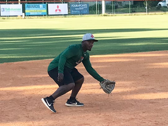 FAMU third baseman Kaycee Reese works on fielding ground balls during practice.