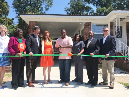 Cornelius Jones (center) cuts the ribbon for the unveiling of the Jake Gaither Home Museum on Wednesday, May 23, 2019. From left to right, he's joined by County Commissioner Mary Ann Lindley, City Commissioner Diane Williams-Cox, Mayor John Dailey, Laura Lee Corbett, independent historic preservation consultant, Reché Jones (wife), Mayor Pro Tem Curtis Richardson and County Commissioner Rick Minor.