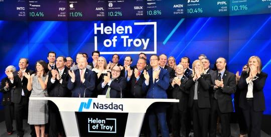 Julien Mininberg, Helen of Troy CEO, center, rings the opening bell May 21 at the Nasdaq stock exchange in New York, along with other company executives.