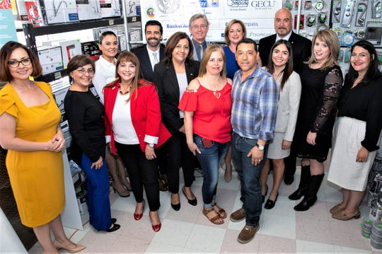 Representatives of companies and organizations celebrate the $170,000 given to Project Vida's microenterprise program May 22 at Gaby and Agustin's (center) Cima Hardware in the Lower Valley. Cima is part of the Project Vida program.