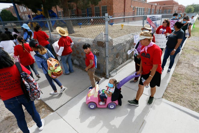 Beall Elementary School parents and students march to Zavala Elementary School to stand for justice in education in the barrio Wednesday, May 22, in El Paso. Both communities are predominantly low-income, Spanish speaking and some don't have access to transportation. The parents are worried EPISD's decision to close the schools would impact the education of the students in the barrio community.