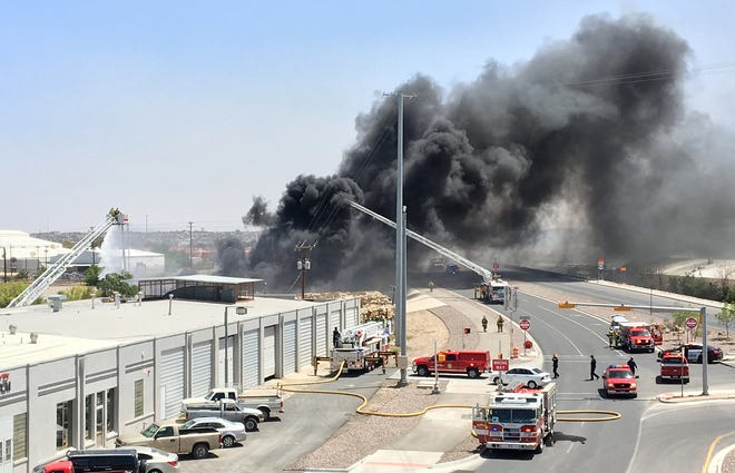 Firefighters battle a fire along Paisano near Delta Thursday afternoon.