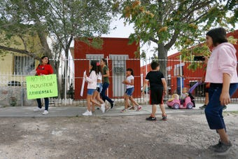 Beall Elementary School parents march to Zavala Elementary School to stand for justice in education in the barrio Wednesday, May 22, in El Paso.